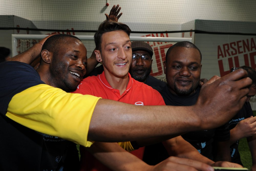 Ozil with members of the Football Therapy Group