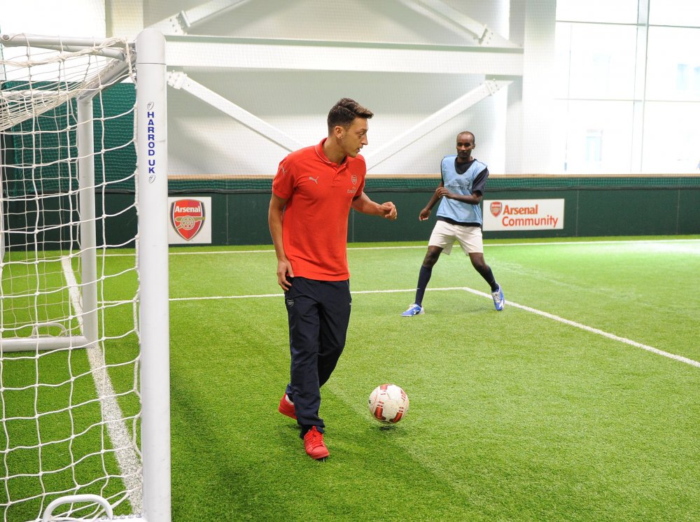 Ozil playing with Freedom from Tortures Football Therapy Group