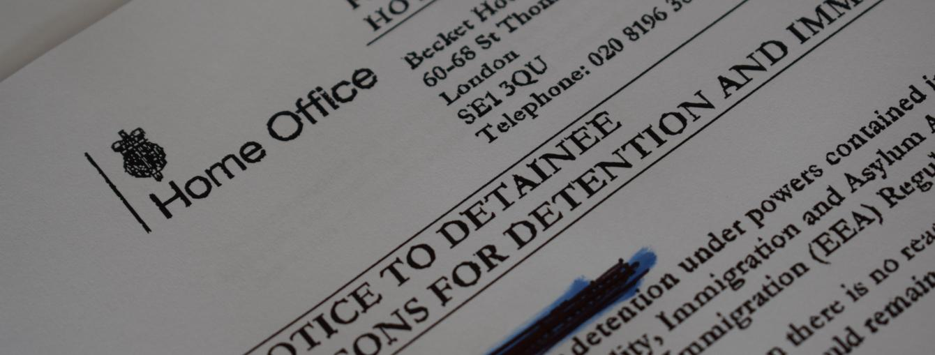Home Office paperwork showing a decision to detain a person