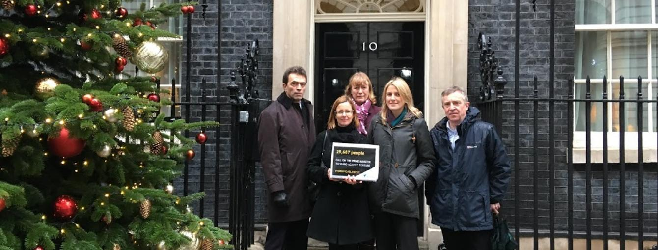 Freedom from Torture outside No. 10 Downing Street, handing in a petition calling on Prime Minister Theresa May to reaffirm the UK's commitment to the ban on torture