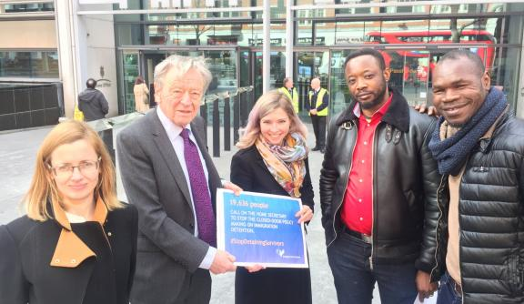 Sonya Sceats, Freedom from Torture Chief Executive, Lord Alf Dubs and members of the Survivors Speak OUT network.